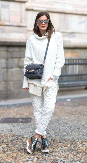 Stylish look with loose sweatshirt, unique pants and metallic platform shoes