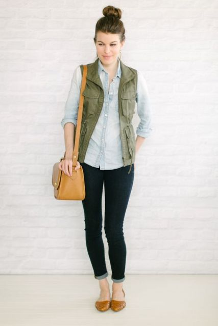 WIth denim shirt, dark color pants and brown shoes