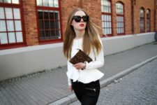White jacket with black trousers and leopard clutch