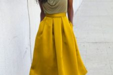 With A-line yellow midi skirt and lace up heels
