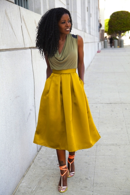 With A line yellow midi skirt and lace up heels