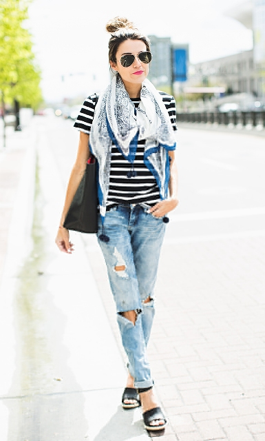 With airy scarf, distressed jeans and sandals