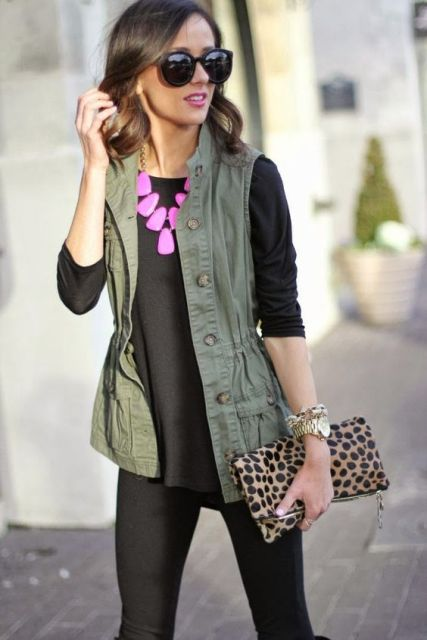 With black clothes, pink necklace and leopard clutch