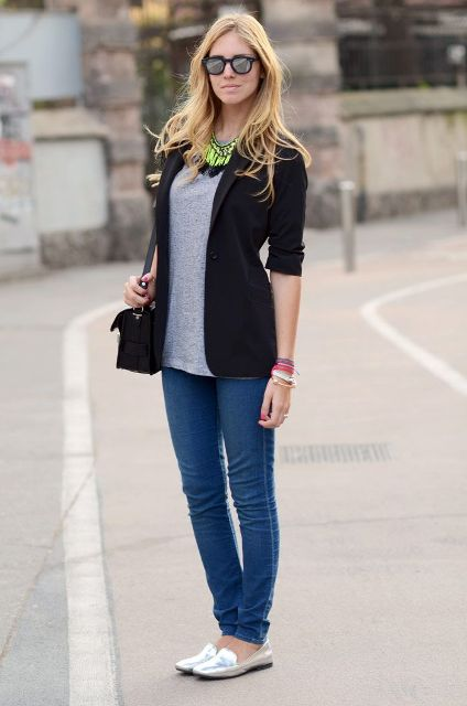 With black jacket, statement necklace and skinny jeans