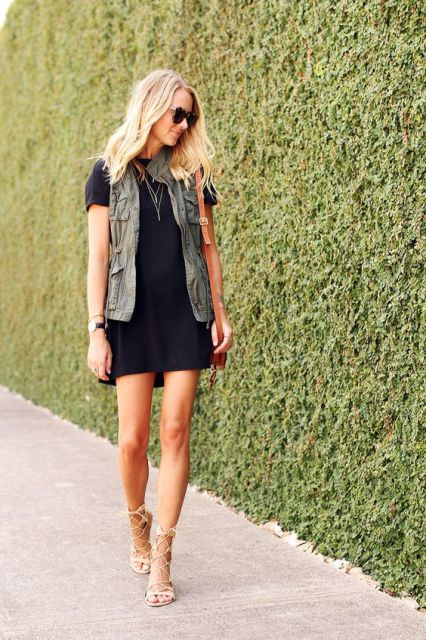 With black mini dress and lace up heels