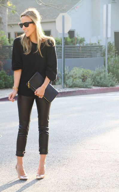 With black pullover, leather pants and clutch