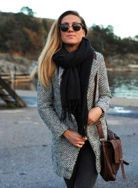 With black scarf and leather bag
