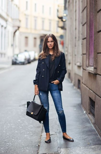 With black shirt, jeans and flats