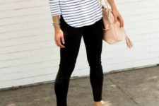 With black trousers and flats