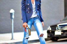 With blue jacket, distressed jeans and pink pumps