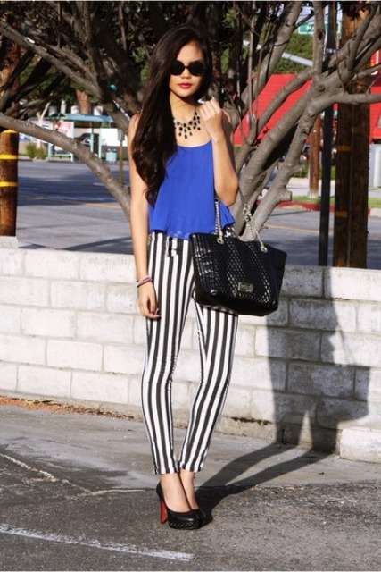With blue shirt, heels and black big bag