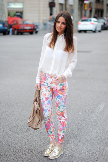 With classic white blouse and floral pants