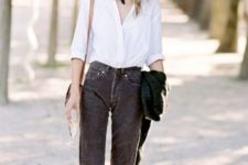 With classic white shirt and loafers
