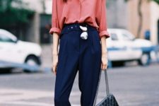 With coral loose shirt and sporty shoes