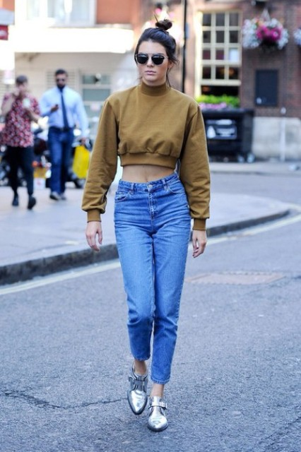 With crop sweatshirt and high waisted jeans