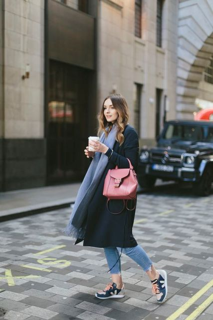 With cropped jeans, sneakers, long scarf and eye-catching bag