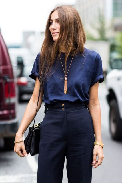 With dark blue t shirt tassel necklace and bag