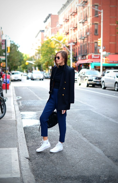 With dark color jacket and white sneakers