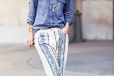With denim button down shirt and metallic heels