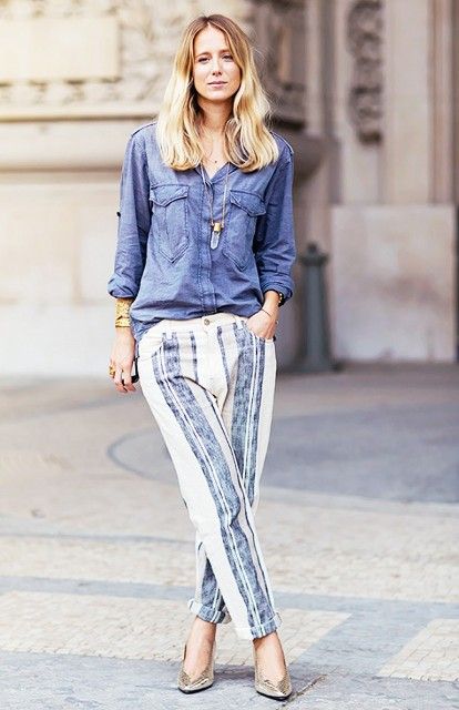 With denim button down shirt and metallic heels