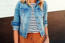 With denim jacket and suede skirt