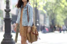 With denim jacket, fringe bag and sandals