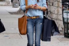 With denim shirt, jeans, leather bag and belt