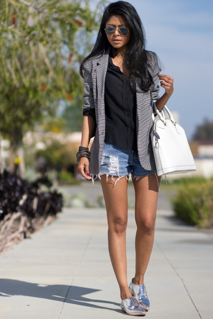 With denim shorts, jacket and white bag