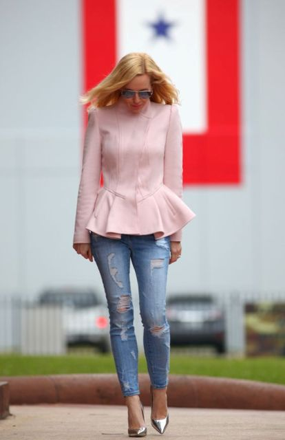 With distressed jeans and metallic pumps