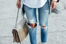 With distressed jeans, crossbody bag and coat