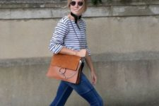 With flared jeans and leather bag
