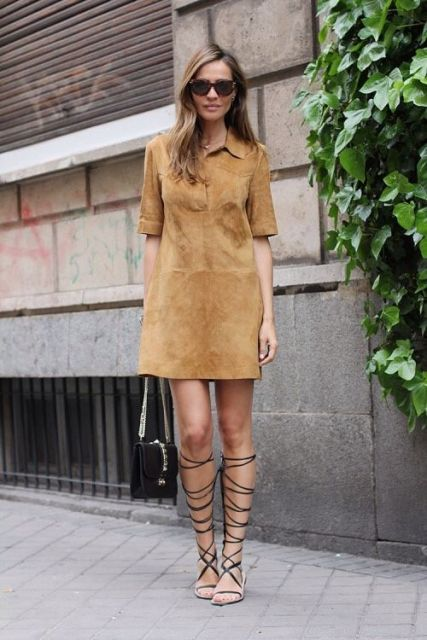 With gladiator sandals and mini bag