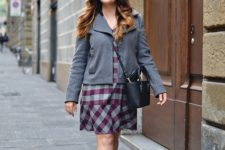 With gray jacket, black crossbody bag and flat boots