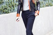 With gray top, leather jacket and black and white shoes