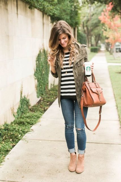 With green army jacket, jeans and ankle boots