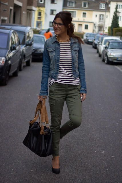With green pants and denim jacket