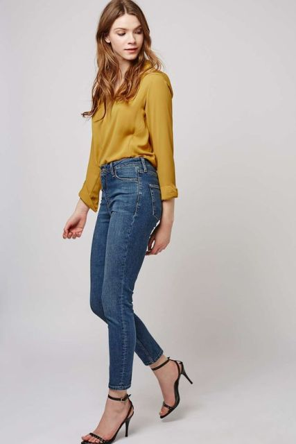 With high waisted skinny jeans and heels