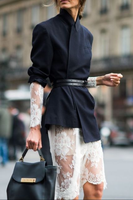 With lace dress and black bag