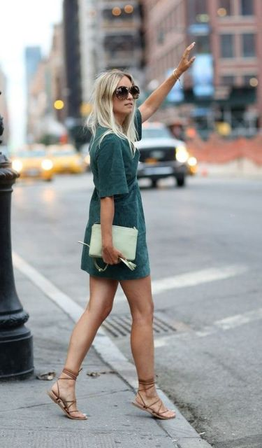 With lace up flat sandals and clutch