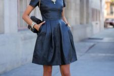 With leather black dress and mini bag