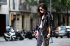 With leather jacket and sandals