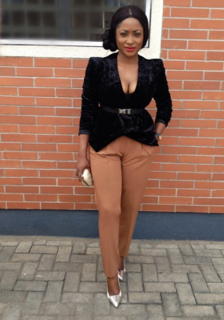 With light brown trousers and metallic pumps