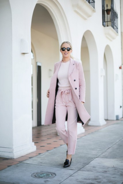 With light pink coat and black loafers
