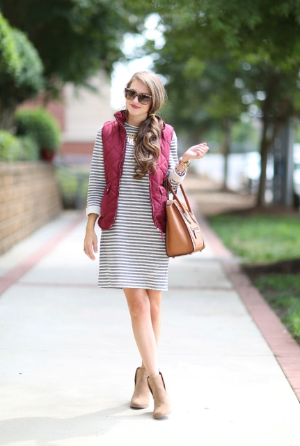 With loose striped dress, ankle boots and leather bag