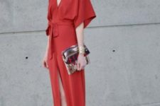 With metallic clutch, neutral heels and sunglasses