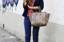 With navy blue jacket and metallic shoes