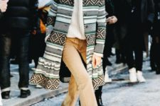 With oversized pullover, printed coat and sunglasses