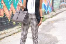 With patterned trousers, white shirt and heels