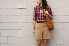With plaid shirt, beige skirt and leather bag