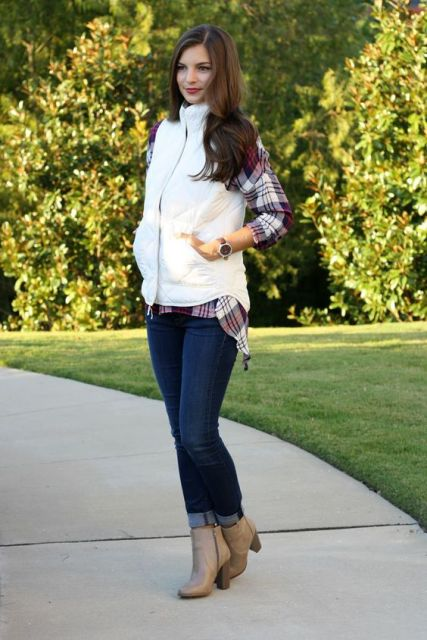 With plaid shirt, cuffed jeans and ankle boots